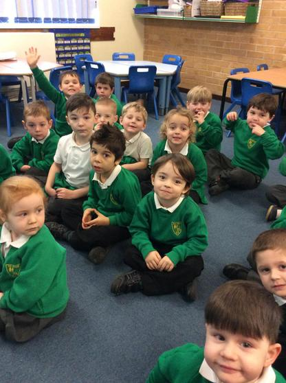 We listen to and join in with songs & rhymes.