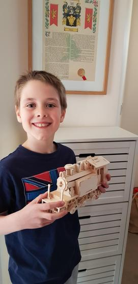 Ryan with his handmade wooden train.