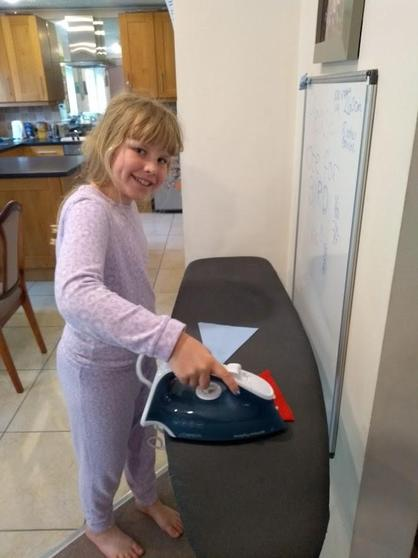 Fiona's learnt to use an iron.