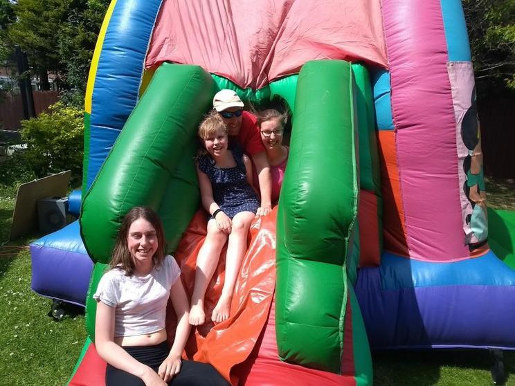 Fiona's family on their bouncy castle.