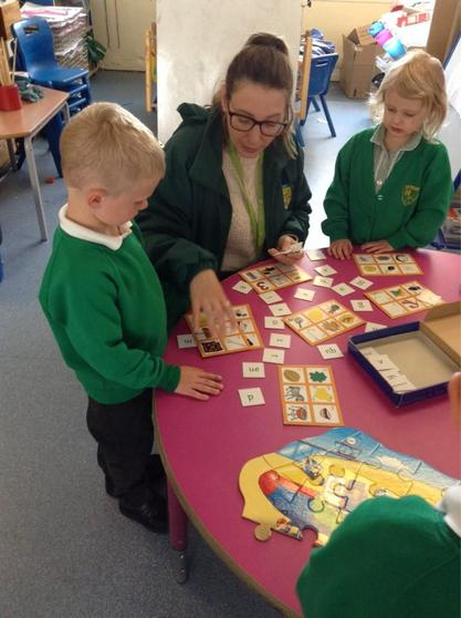 We play games to help children hear and recognise the letter sounds.