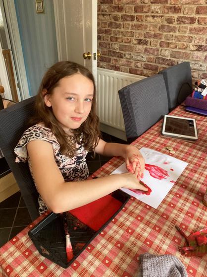 Louisa doing her printing for Art.