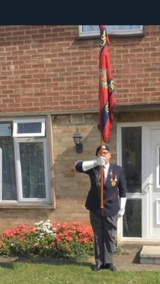 Amelia's Grandad holding the Royal Engineers Flag.