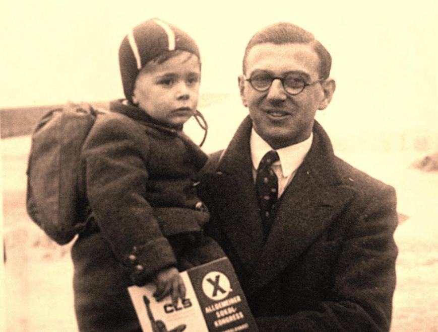Young Nicholas Winton with a rescued child