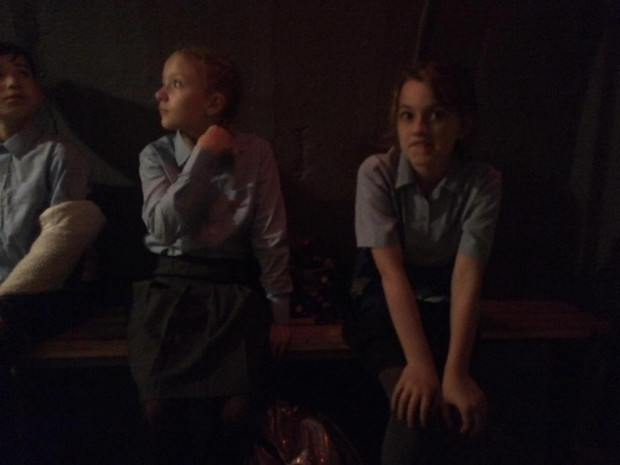 Ruby looking pensive in the air raid shelter