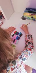Chloe completing her multiplication work.