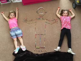 Abigail and Chloe learning about symmetry.