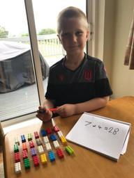 Logan using Lego to learn about arrays