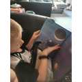 Zak reading a book about space.