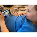 Theo is enjoying Mrs Humpleby's YouTube story.