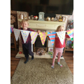 Alfie and Harper with their bunting.