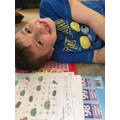 Theo practising numbers to 100.