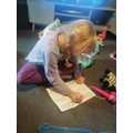 Neve is working hard on her Maths.