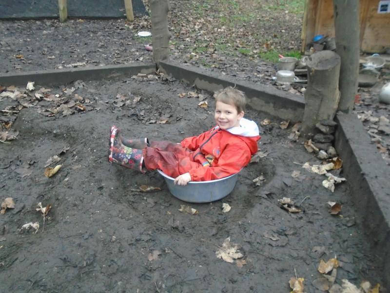 Having a mud bath!