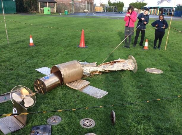 Let's investigate: a satellite has crash landed on the school field!