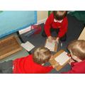 Drawing minibeasts in the minibeast hide.