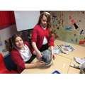 We used Papier Mache to make our planet bases.