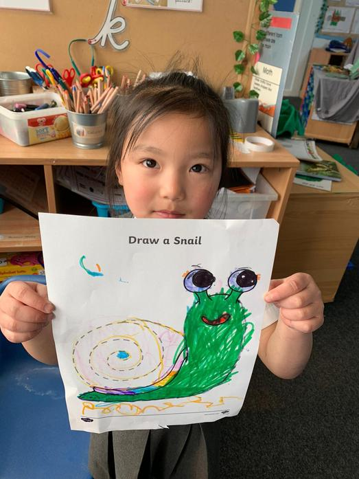 Using fine motor skills to draw a snail