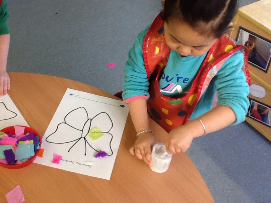 We collaged butterflies using tissue paper and glue.