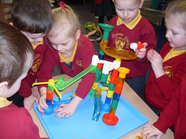 Building a marble run together.