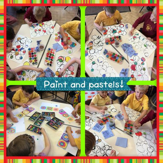 Using paint and pastel to create circles.