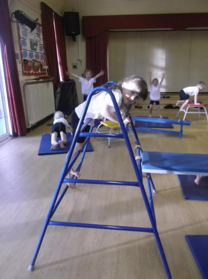 Exploring the gymnastics apparatus.