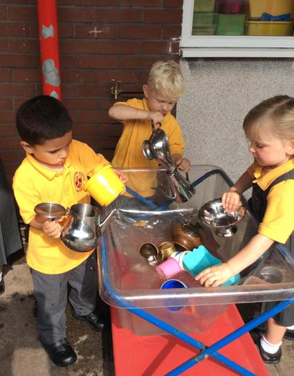 Pouring water with our shiny teapots and jugs.