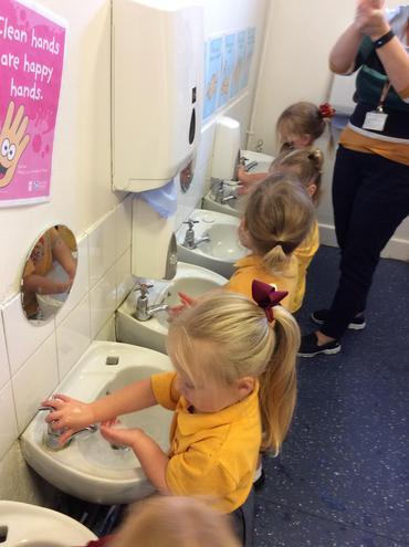 Practising good hand washing.