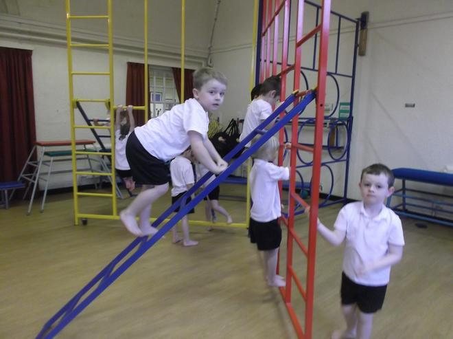 Climbing the large apparatus.