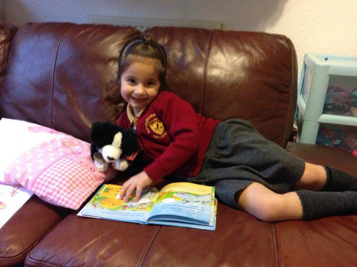 Jess the reading dog being read to.