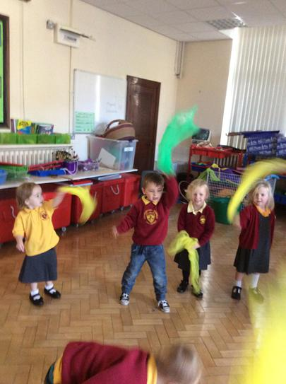 Making firework shapes with scarves...