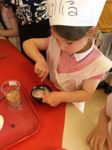 Mixing yoghurt and rasberries