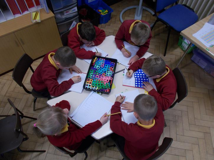 We have fun using Numicon in Maths.