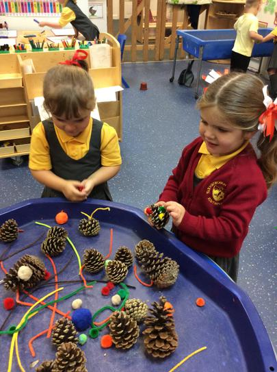 Pine cones, pom poms and pipe cleaners.