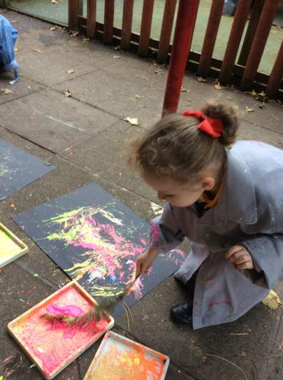 Painting with twigs, leaves and conkers.
