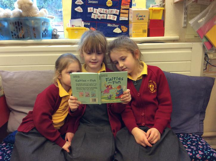 Sharing a book.