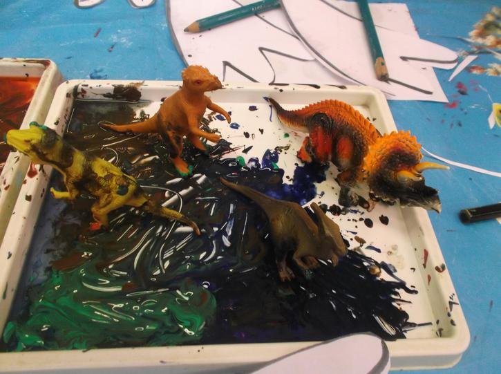 Painting with dinosaur figures.
