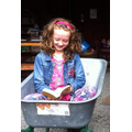 Lauren reading whilst sat in a wheelbarrow!