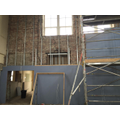 The wall at the back of the hall being boarded.