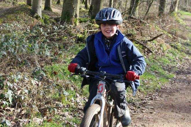 Year 4 cycling in woodlands.