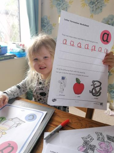 Bethany's sister loving home learning!