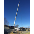 Crane to lift machinary for the roof fitting