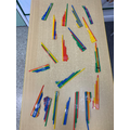 We made straw pan pipes.