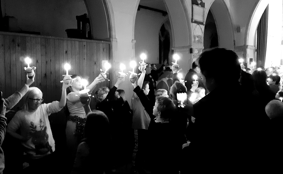 The celebration is named after the Christingles that are lit during the celebration. Christingles are made from an orange decorated with red tape, sweets and a candle. They have been part of our history for the last 50 years. We ask those who celebrate Christingle to hold a collection to support children and young people in the darkest situations imaginable. We raised money for the Children's Society.