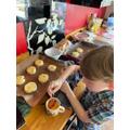 Preparing the scones for baking.