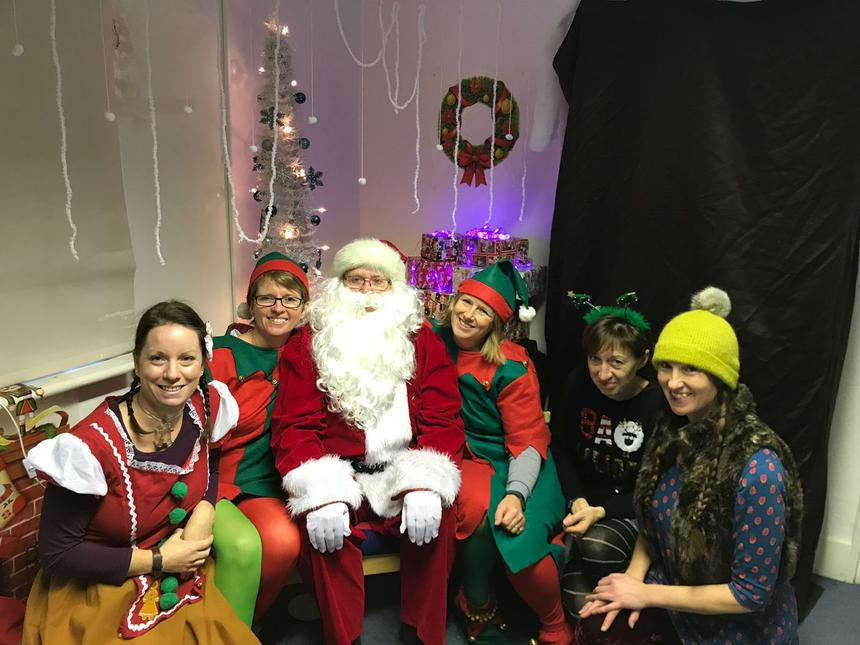 Father Christmas and the team of elves