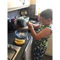 Preparing the bananas.