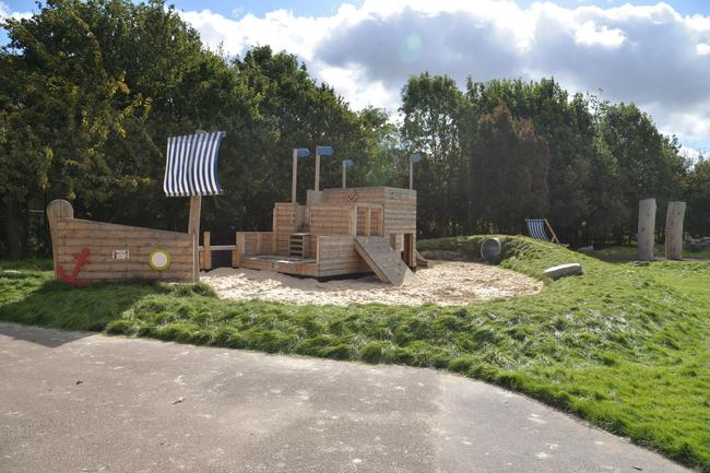 Sandpit, earth mounds and pirate ship