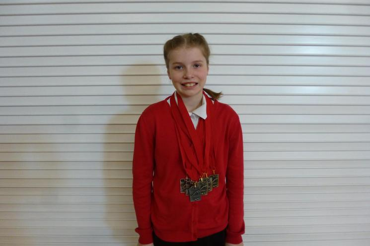 Well done Isabelle Y6 - Medal Success