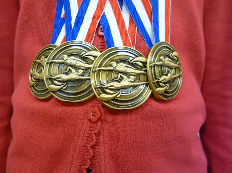 Four golds - 100IM, 100Free, 50m Back & 50m Breast